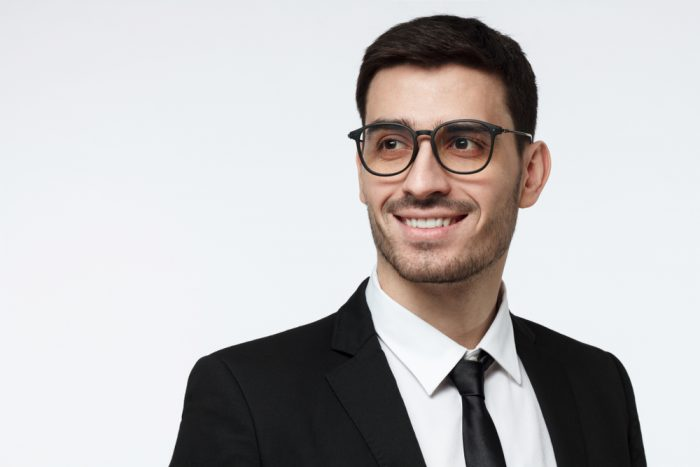 Closeup,Shot,Of,Young,Corporate,Advisor,In,Trendy,Spectacles,Pictured