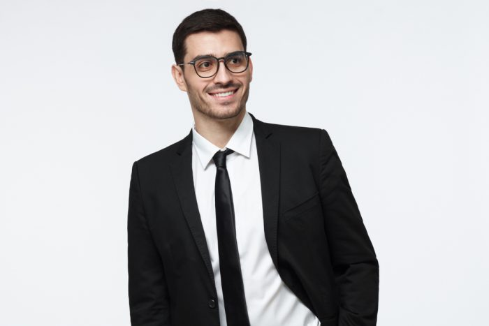 Modern,Business,Man,In,Black,Suit,Looking,Away,While,Standing